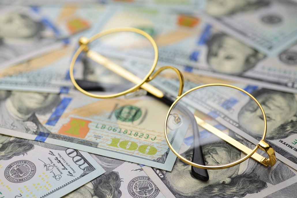 Gold filled wire rim eyeglasses with 100 dollar bills